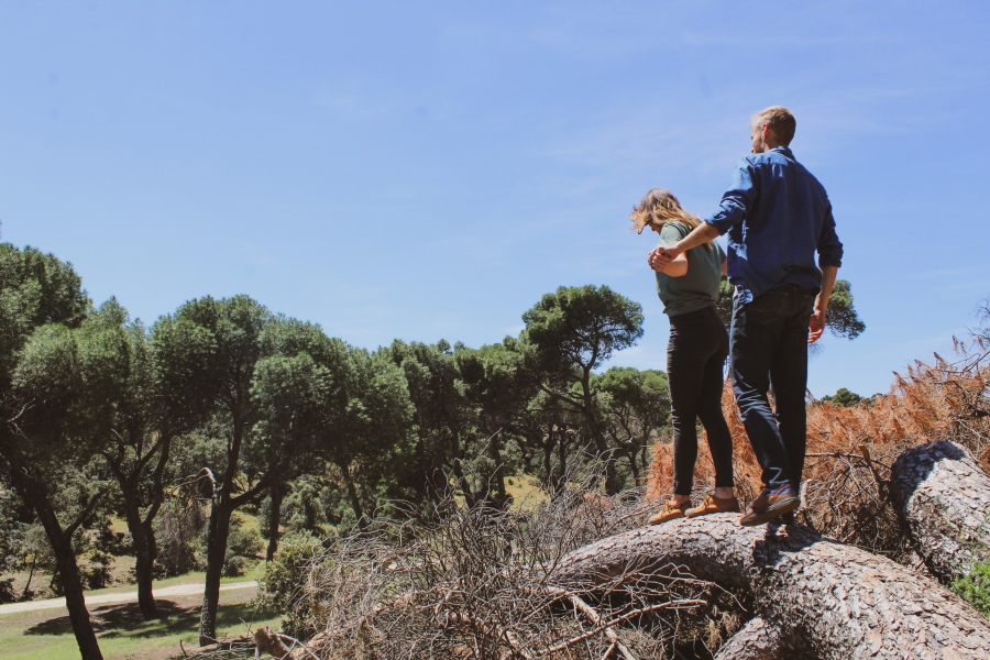 Couple walking on a tree in Casa de Campo, Madrid, Spain